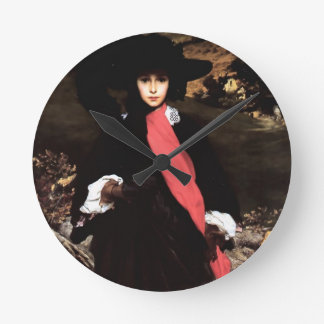 Extravagant young lady painting round wallclock