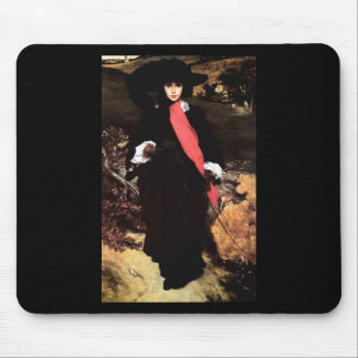 Extravagant young lady painting mouse pad