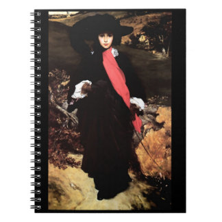 Extravagant young lady painting spiral notebooks