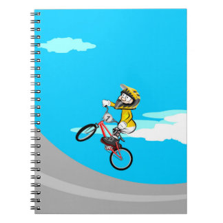 Extreme bicycle BMX in the incline of the park Spiral Notebook