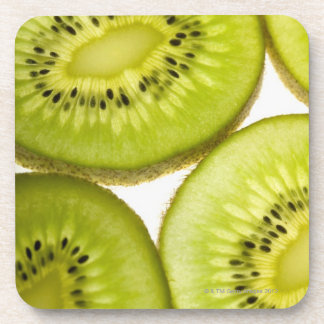 Extreme close-up of four pieces of sliced kiwi beverage coasters