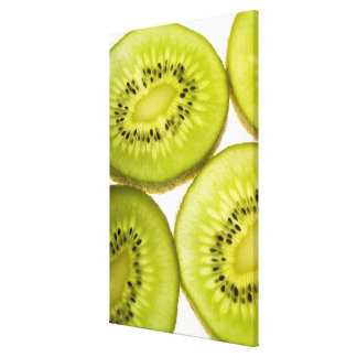 Extreme close-up of four pieces of sliced kiwi canvas print