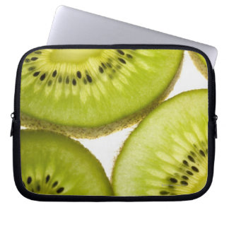Extreme close-up of four pieces of sliced kiwi laptop sleeve