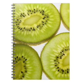 Extreme close-up of four pieces of sliced kiwi spiral notebook