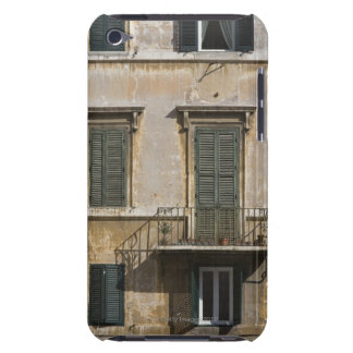 facade of building with a balcony and shuttered barely there iPod cases