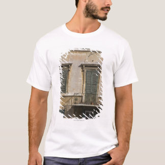 facade of building with a balcony and shuttered T-Shirt
