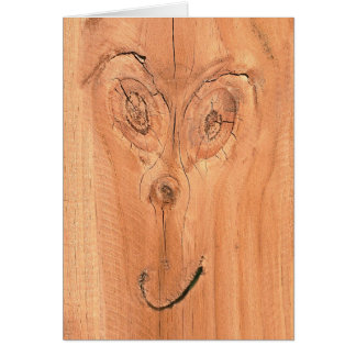 Face in the wood card