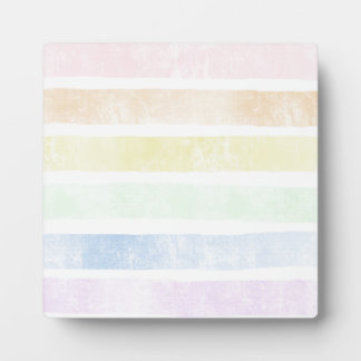 Faded color background stripes display plaque