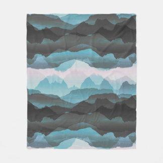 Faded stylised blue mountains fleece blanket