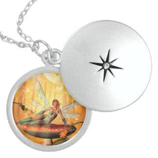 Fairy sitting on a mushroom round locket necklace