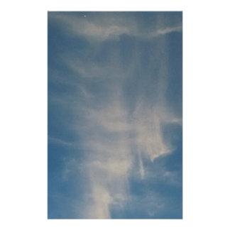 Falling blue sky drapes stationery paper