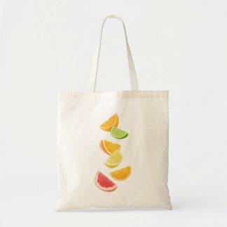 Falling citrus slices tote bag