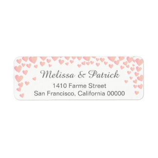 falling pink love hearts confetti on white wedding
