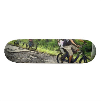 Family cycling on a dirt track skate boards