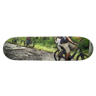 Family cycling on a dirt track skate board deck