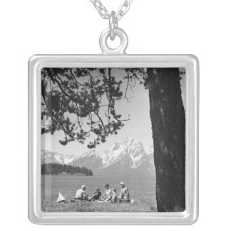 Family having picnic by lake mountains silver plated necklace