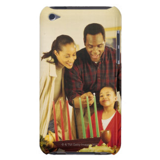 Family lighting the Kinara for Kwanzaa Barely There iPod Covers