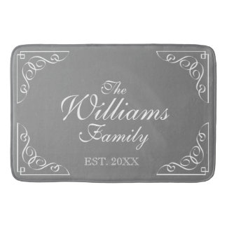 Family Name Est. gray bath mat with elegant swirls