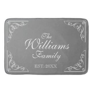 Family Name Est. grey bath mat with elegant swirls
