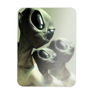 Family of aliens huddled together. rectangular photo magnet