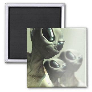 Family of aliens huddled together. square magnet
