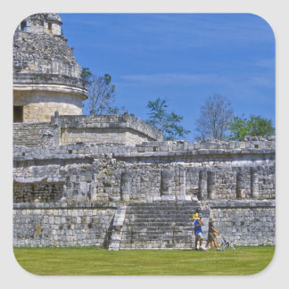 Family of tourists walk past ancient Mayan Square Sticker