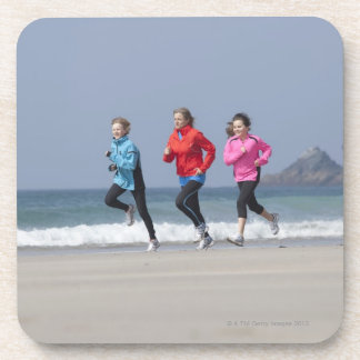 Family running together on beach beverage coaster