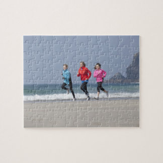 Family running together on beach jigsaw puzzle