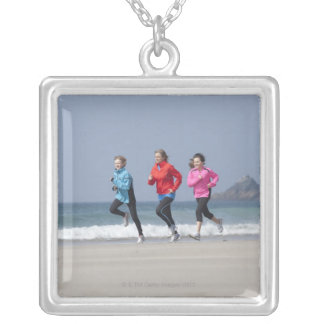 Family running together on beach silver plated necklace