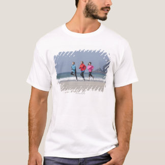 Family running together on beach T-Shirt