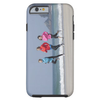 Family running together on beach tough iPhone 6 case