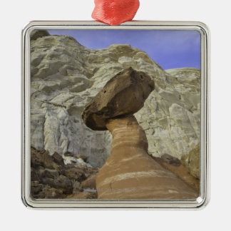 Fanciful toadstool shape of eroded red and white christmas ornament