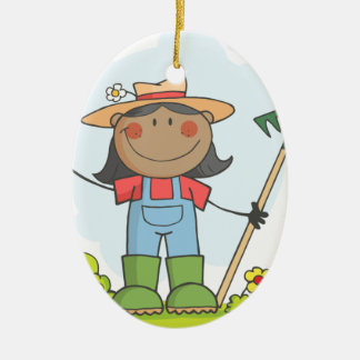 Farmer girl with a rake in grass with flowers ceramic oval decoration