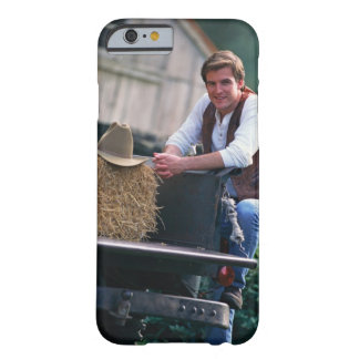 Farmer posing by pickup truck with hay bale barely there iPhone 6 case