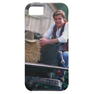 Farmer posing by pickup truck with hay bale tough iPhone 5 case