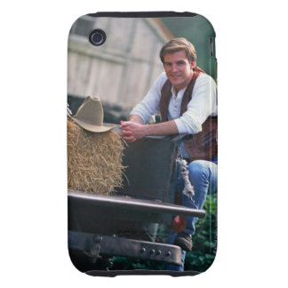 Farmer posing by pickup truck with hay bale iPhone 3 tough cover