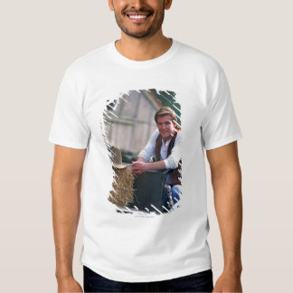 Farmer posing by pickup truck with hay bale tshirt