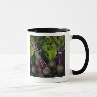 farmers market stand with various produce/ 2 mug