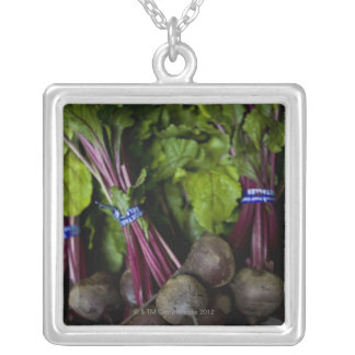 farmers market stand with various produce/ 2 silver plated necklace