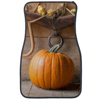 Farmers Museum. Pumpkin in barn with bale of hay Car Mat