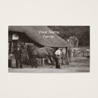 Farrier shoeing a horse business card
