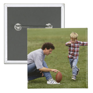 Father and son (4-6) playing American football 15 Cm Square Badge