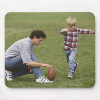 Father and son (4-6) playing American football Mouse Pad