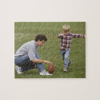 Father and son (4-6) playing American football Puzzles