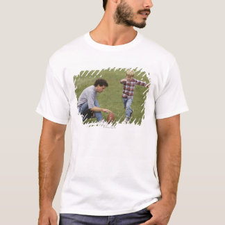 Father and son (4-6) playing American football T-Shirt
