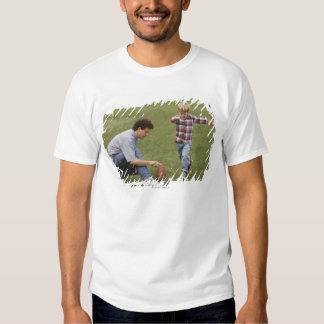 Father and son (4-6) playing American football Tee Shirts