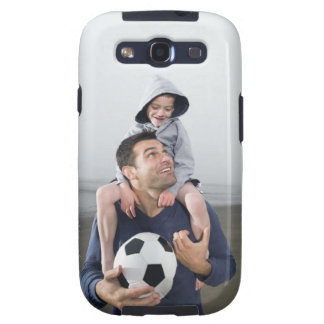 Father carrying son on shoulders and holding samsung galaxy s3 cover