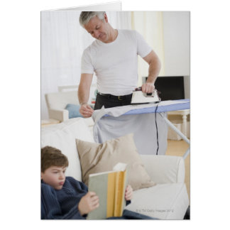 Father ironing greeting card
