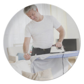 Father ironing plate