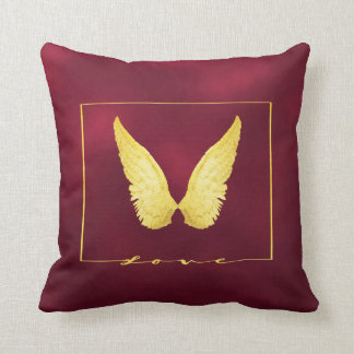Faux gold angel wings on chic burgundy background cushion